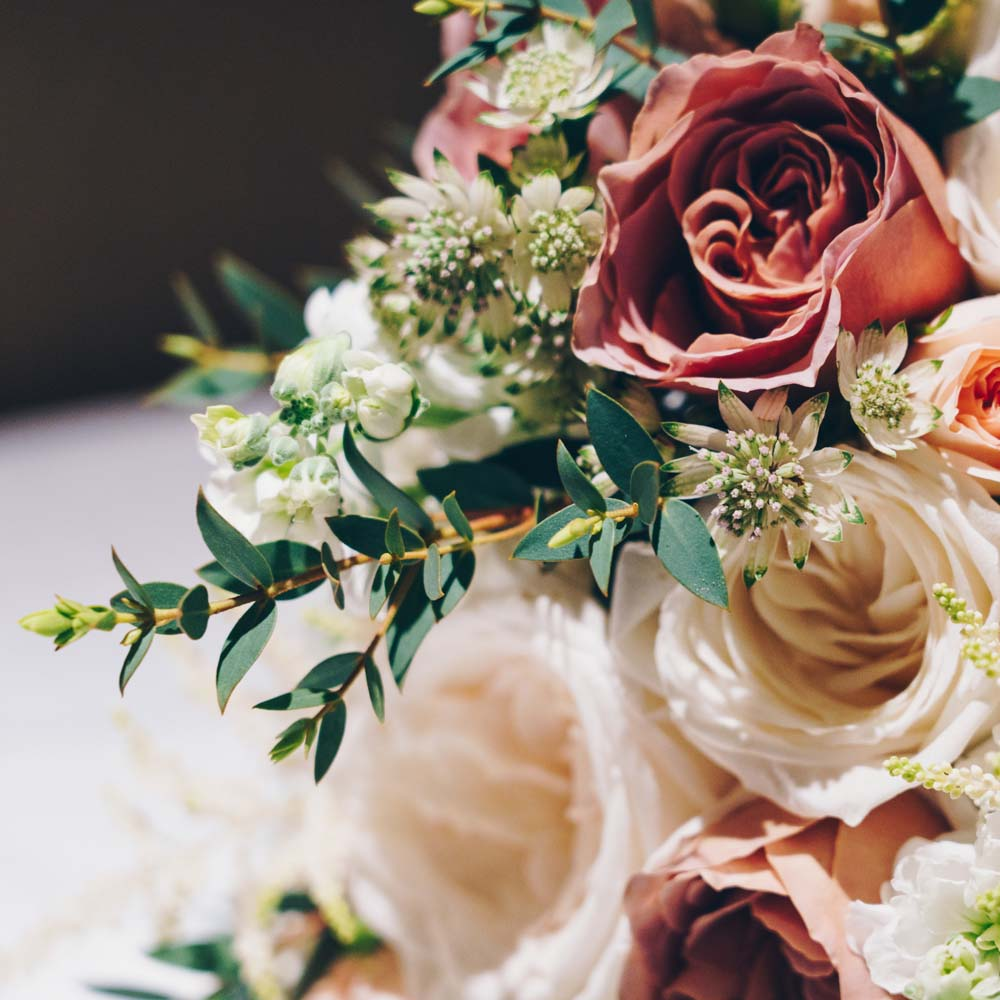 Closeup shot of a beautiful flower composition for a wedding ceremony on a blurred background